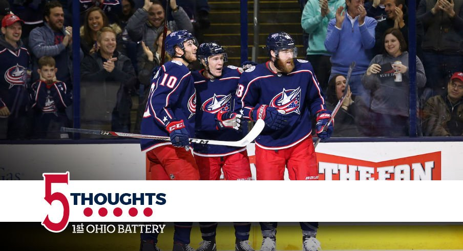 Blue Jackets celebrate a goal against the Detroit Red Wings