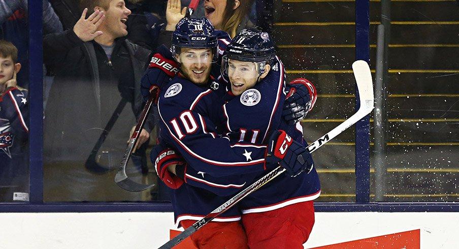 Matt Calvert and Alexander Wennberg celebrate a shorthanded goal against the Detroit Red Wings.