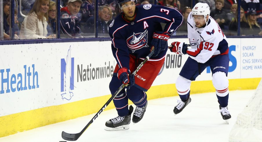 Seth Jones defends against Capitals center Evgeny Kuznetsov