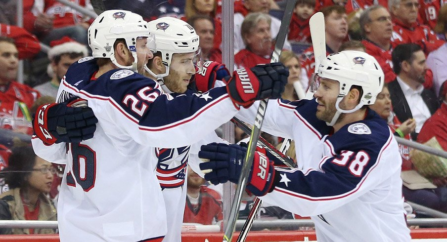 Boone Jenner and Alexander Wennberg celebrate a second period goal against the Capitals.