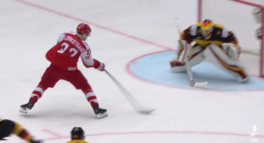 Oliver Bjorkstrand races in against Germany.