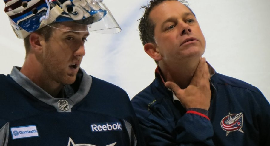 Ian Clark chats with goaltender Jeremy Smith during the Blue Jackets' development camp