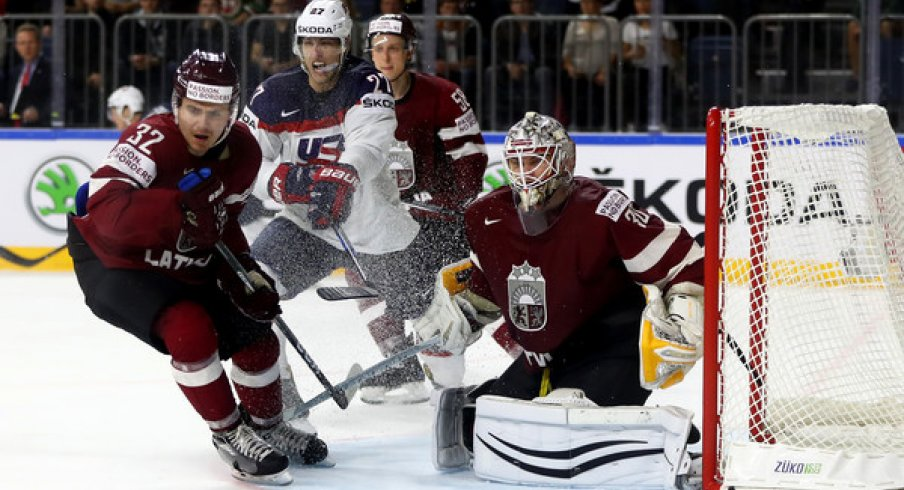 Elvis Merzlikins saves the puck for Latvia against Team USA