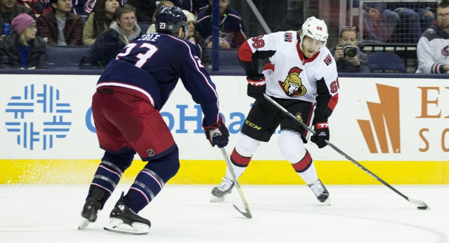Ian Cole tries to stop Mike Hoffman in a late season game of the Blue Jackets against the Senators