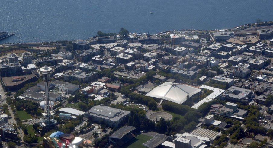 A photo of Seattle from the sky including the Space Needle and Key Arena