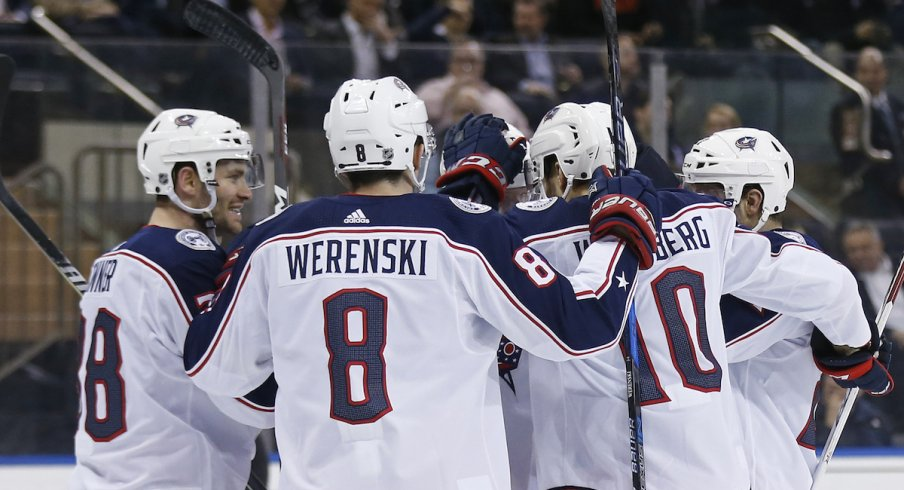 The Blue Jackets celebrate a goal against the New York Rangers at Madison Square Garden.