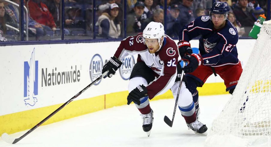 Columbus Blue Jackets defenseman Ryan Murray defends against Colorado Avalanche forward Gabriel Landeskog during a game at Nationwide Arena.
