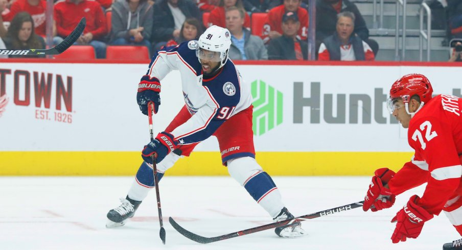 Columbus Blue Jackets forward Anthony Duclair makes a play in the team's season opener against the Detroit Red Wings at Little Caesars Arena.