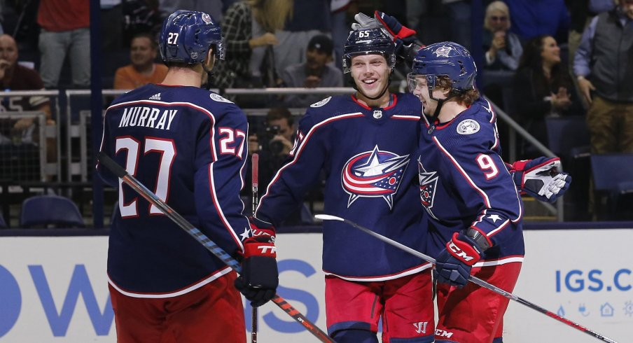 Ryan Murray, Markus Nutivaara and Artemi Panarin celebrate after a third period goal against the Colorado Avalanche on Tuesday.