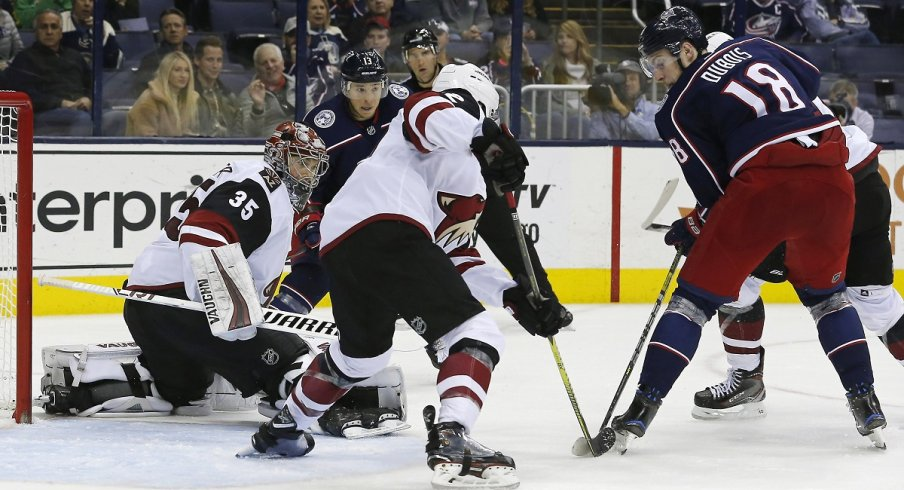 Pierre-Luc Dubois battles for a puck during the third period of the Blue Jackets ugly loss to the Arizona Coyotes