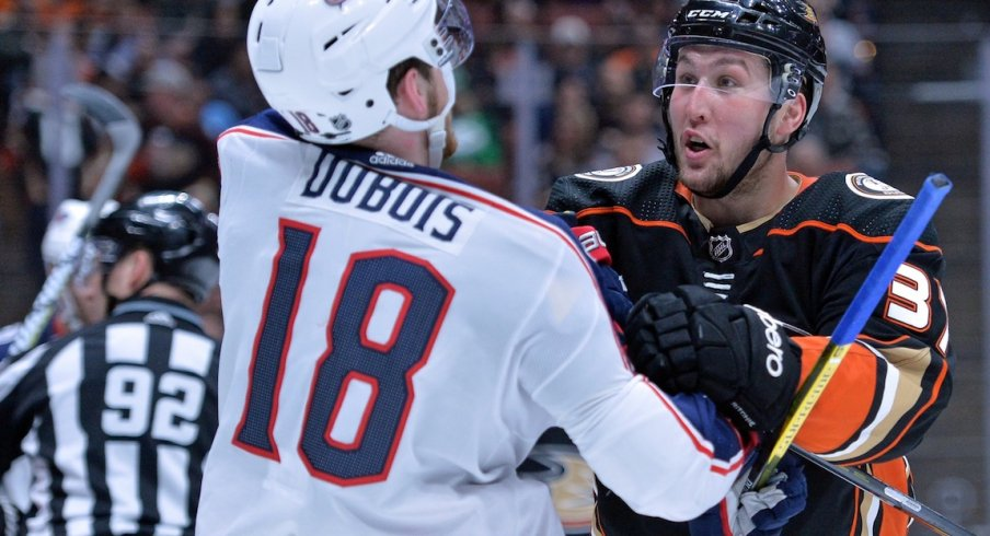 Pierre-Luc Dubois gets into it with Ducks forward Nick Ritchie