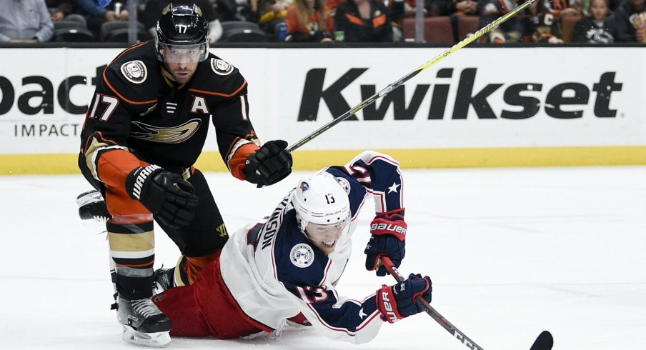 Columbus Blue Jackets' forward Cam Atkinson gets tripped up fighting for a puck on Sunday night against the Anaheim Ducks.