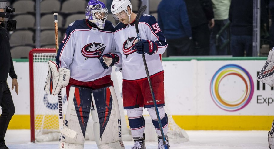 David Savard celebrates a big road win with Sergei Bobrovsky