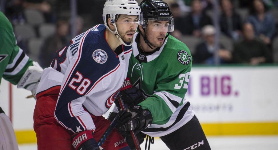Oliver Bjorkstrand battles in front of the net with Dallas Stars defensemen Joel Hanley