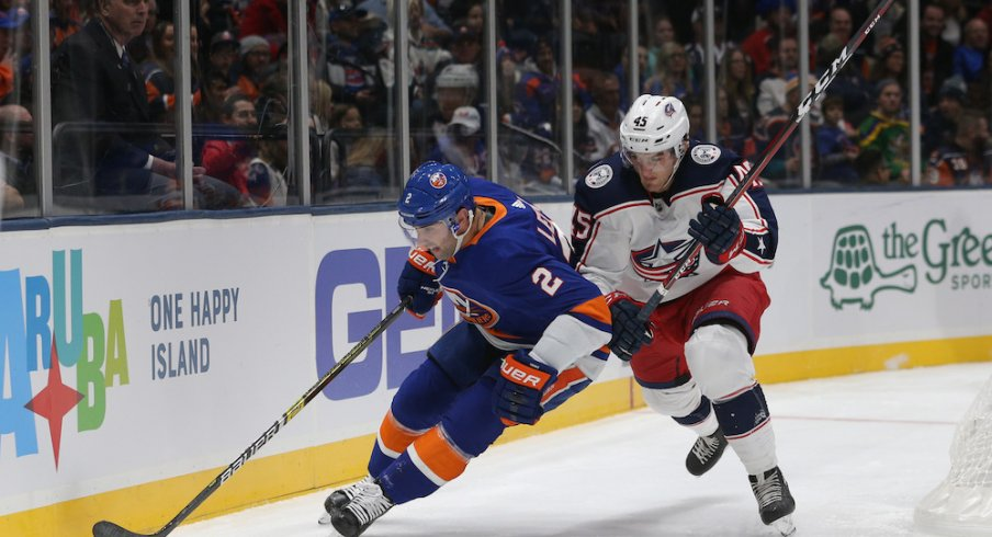Columbus Blue Jackets center Lukas Sedlak defends against Islanders defenseman Nick Leddy at Nassau Coliseum.