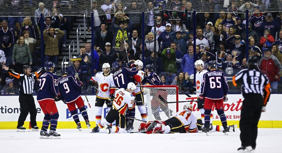 Mike Smith of the Calgary Flames makes a big save against the Blue Jackets.