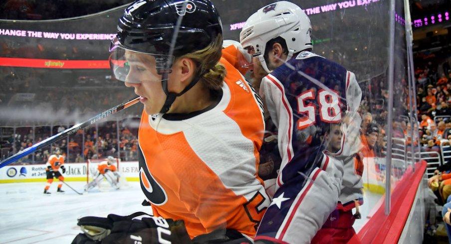 Columbus Blue Jackets defenseman David Savard defends against the Philadelphia Flyers at Wells Fargo Center.