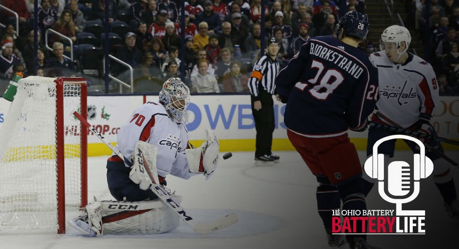Oliver Bjorkstrand works to get a shot on goal against the Capitals Braden Holtby