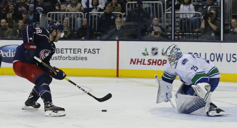 Boone Jenner on a breakaway against Jacob Markstrom