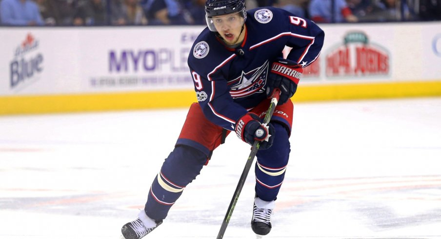 Artemi Panarin skates with the puck against the Los Angeles Kings