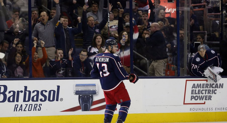 Cam Atkinson reacts to scoring a goal at Nationwide Arena.