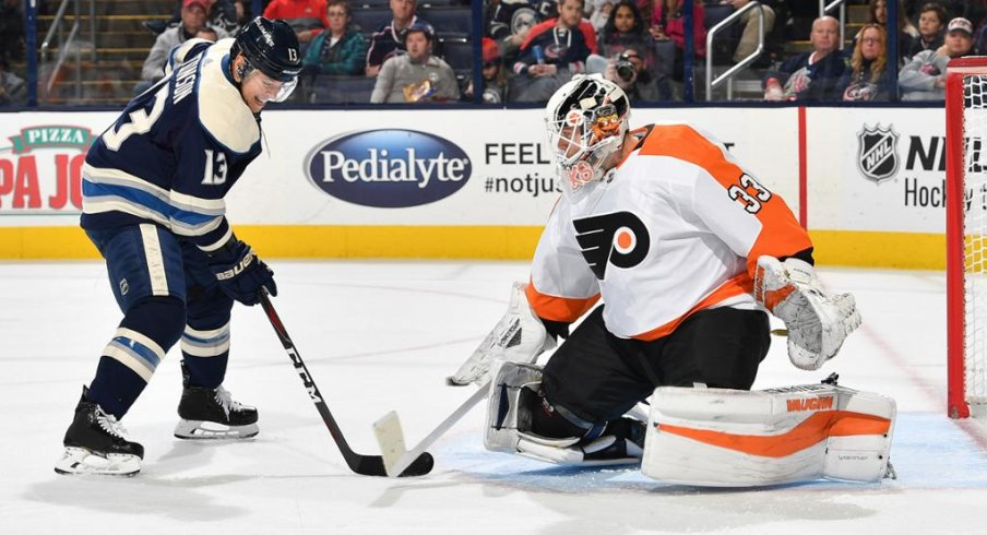 Cam Atkinson faces off against Flyers goalie Calvin Pickard