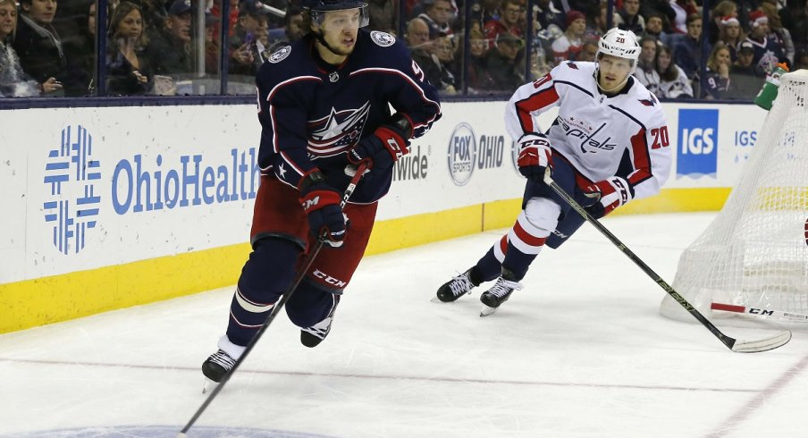 Artemi Panarin skates with the puck against the Washington Capitals