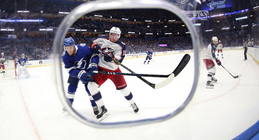 Pierre-Luc Dubois fights for a puck with Dan Girardi at Amalie Arena in Tampa Bay, Florida.