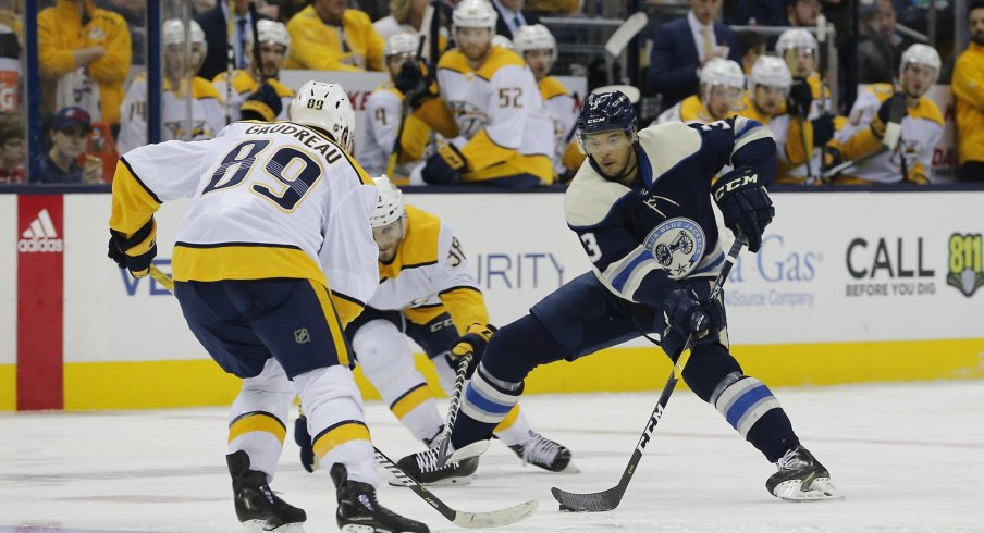 Seth Jones looks to make a move in a 4-3 overtime victory for the Columbus Blue Jackets against the Nashville Predators.