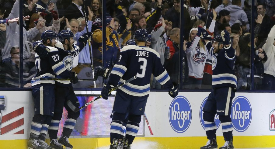 Ryan Murray Seth Jones and Nick Foligno celebrate with Boone Jenner after scoring against the Nashville Predators