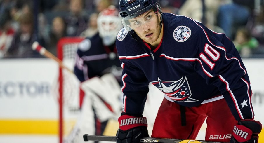 Alexander Wennberg looks to win a faceoff against the Chicago Blackhawks at Nationwide Arena.