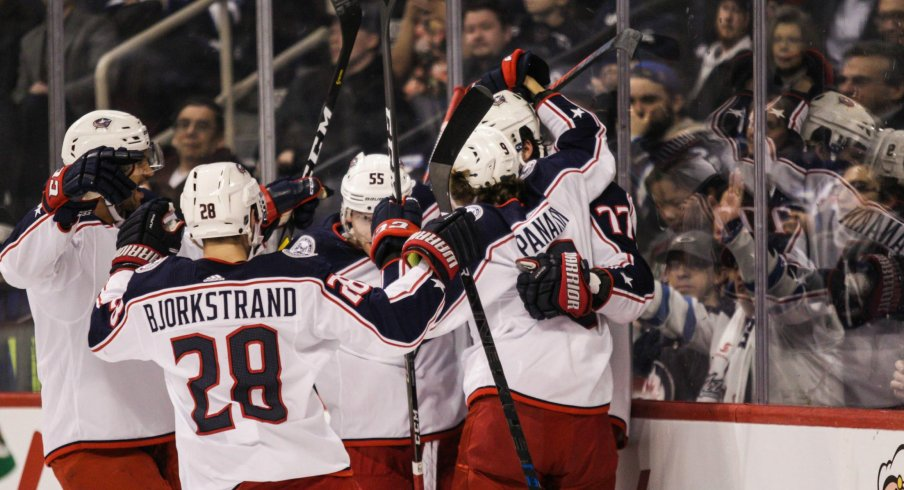 Oliver Bjorkstrand Artemi Panarin Seth Jones and Mark Letestu celebrate with Josh Anderson after his first period goal in Winnipeg.