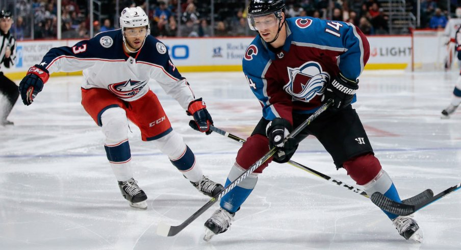 Columbus Blue Jackets defenseman Seth Jones defends against Blake Comeau of the Colorado Avalanche at Pepsi Center in Denver.