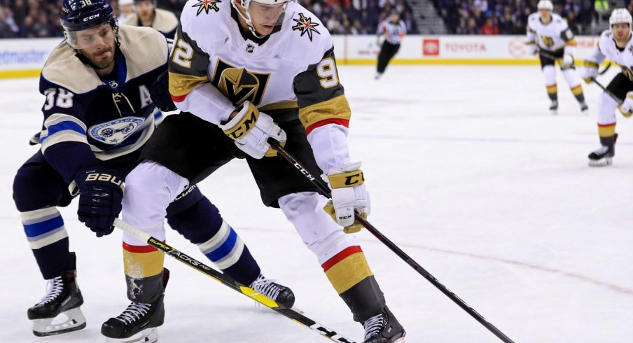 Boone Jenner battles with Golden Knights player Tomas Nosek