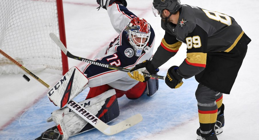 Columbus Blue Jackets goaltender Sergei Bobrovsky makes a breakaway save on Vegas Golden Knights forward Alex Tuch.