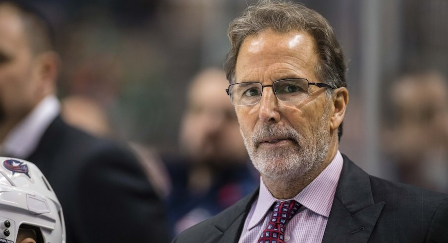 John Tortorella watches the ice as the Blue Jackets attempt to score.