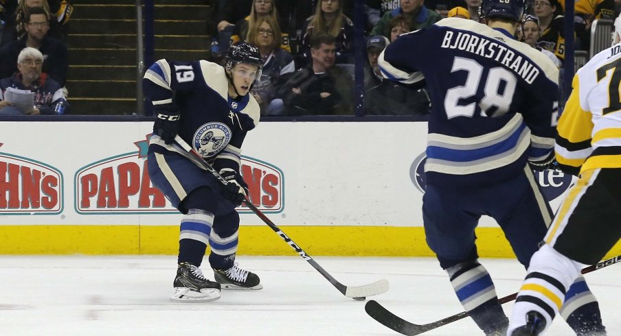 Ryan Dzingel carries the puck against the Pittsburgh Penguins at Nationwide Arena