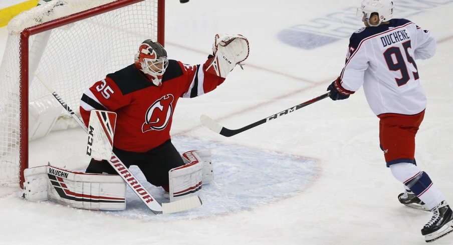 Cory Schneider keeps the puck out of the net against Matt Duchene during the first period at Prudential Center.