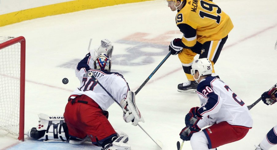 Columbus Blue Jackets goaltender Joonas Korpisalo (70) makes a save against Pittsburgh Penguins center Jared McCann (19) during the second period at PPG PAINTS Arena.