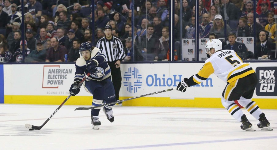 Columbus Blue Jackets left wing Artemi Panarin (9) passes the puck against the Pittsburgh Penguins during the second period at Nationwide Arena.