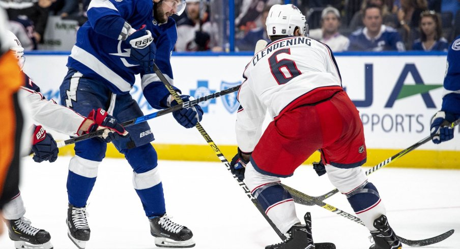 Adam Clendening goes up against Nikita Kucherov as the Columbus Blue Jackets take on the Tampa Bay Lightning