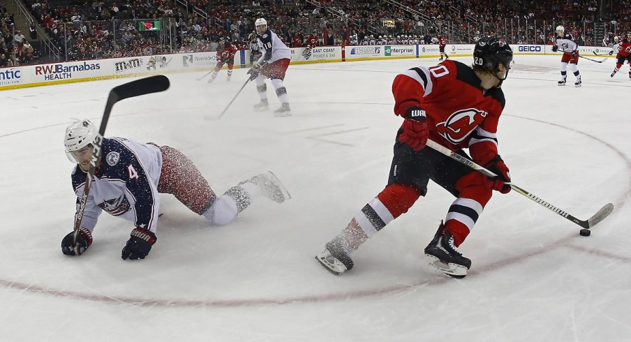 Blake Coleman spins away from Scott Harrington at Prudential Center