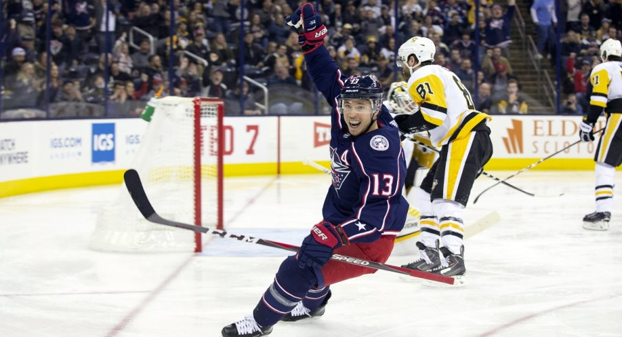 Cam Atkinson celebrates after scoring a shorthanded goal at Nationwide Arena