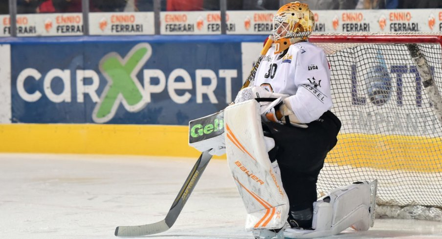 Elvis Merzlikins looks on in a game for Lugano HC of the NLA
