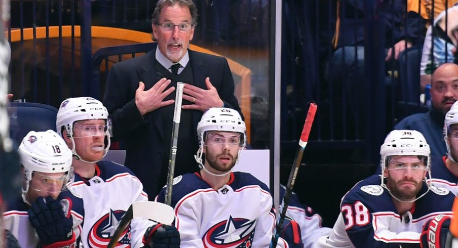 John Tortorella demands an explanation from the refs after a particularly contentious play.