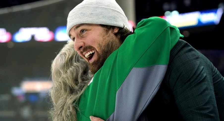 Keith Kinkaid hugs a fan post-game after the Columbus Blue Jackets St. Patrick's Day game