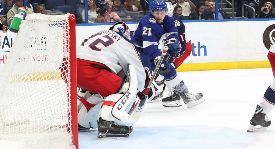 Columbus Blue Jackets goaltender Sergei Bobrovsky watches as Tampa Bay Lightning forward Brayden Point controls the puck at Amalie Arena.