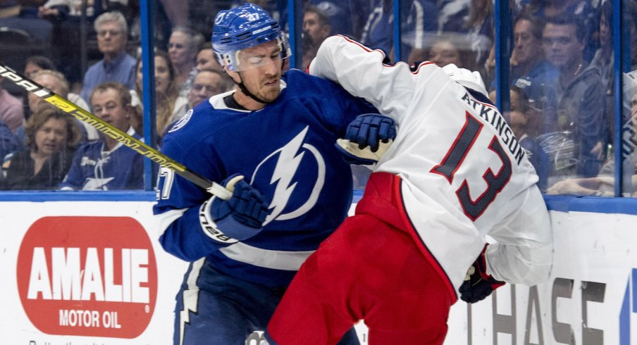 Columbus Blue Jackets forward Cam Atkinson collides with Tampa Bay Lightning defenseman Ryan McDonagh during a game at Amalie Arena in Tampa, Florida.