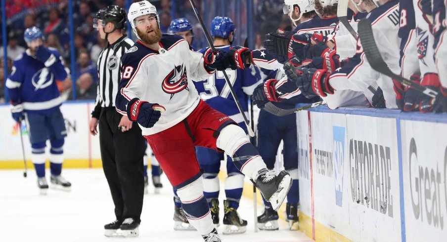 Columbus Blue Jackets defenseman David Savard (58) celebrates with teammates as after scoring a goal against the Tampa Bay Lightning during the third period of game one of the first round of the 2019 Stanley Cup Playoffs at Amalie Arena.