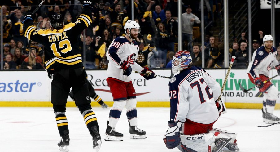 Apr 25, 2019; Boston, MA, USA; Boston Bruins center Charlie Coyle (13) celebrates after scoring the game winning against Columbus Blue Jackets goaltender Sergei Bobrovsky (72) during the overtime period in game one of the second round of the 2019 Stanley Cup Playoffs at TD Garden.